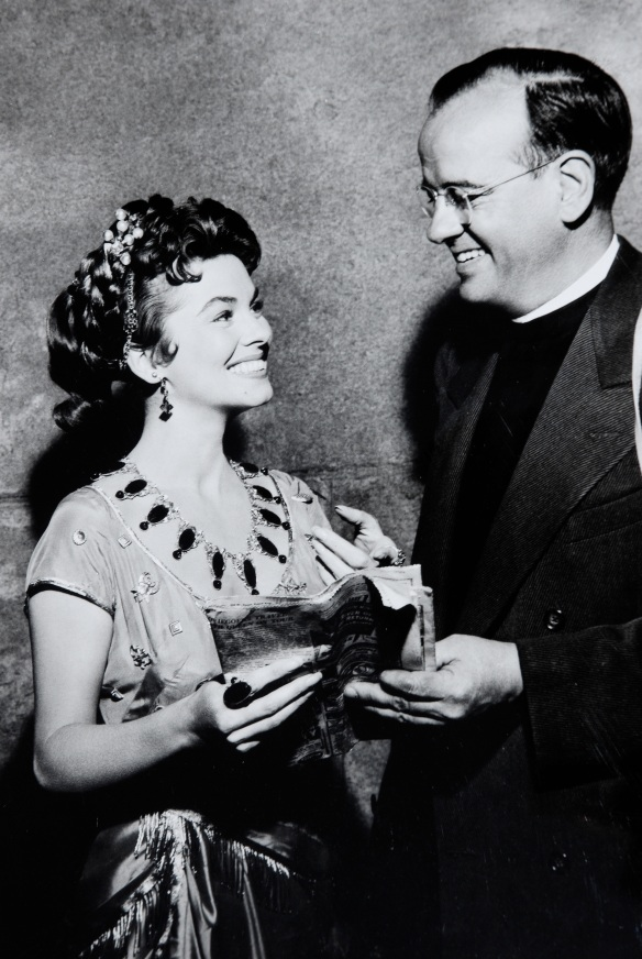 "My father, the Rev. James K. Friedrich, with Joanne Dru on the set of ""Day of Triumph"" (1954)."
