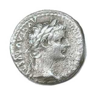 Roman coin with the head of the emperor Tiberius. The inscription may contain a claim of divinity.